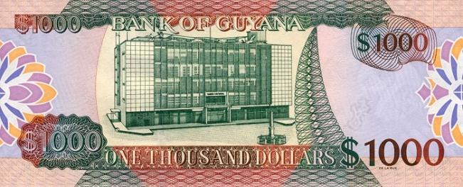 Гайанский доллар. Купюра номиналом в 1000 GYD, реверс (обратная сторона).