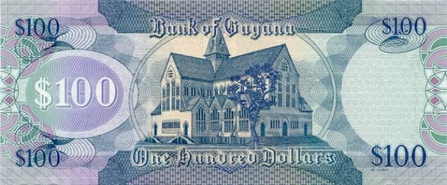 Гайанский доллар. Купюра номиналом в 100 GYD, реверс (обратная сторона).