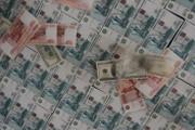 Рубль на минимуме, доллар взлетел