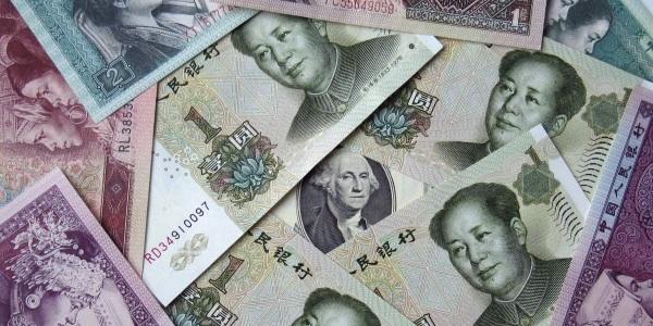 Финансовые центры соревнуются за право торговать юанями